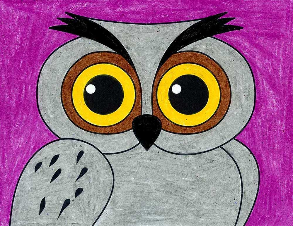 A drawing of an owl face, made with the help of an easy step by step tutorial.